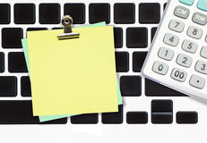 Blank paper note with metal clip on computer Stock Photos