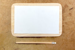 Blank paper note and pencil Stock Image