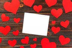 Blank paper note with red heart shape on grunge wooden background.  Stock Images