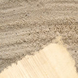 Blank paper note in sand beach texture Stock Photography