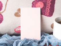 Blank paper note for Valentine`s day and coffee mug Royalty Free Stock Photos
