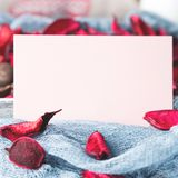 Blank paper note for Valentine`s day flower. Blank paper note for Valentine`s or mother day. Background with dried flower petals Stock Image