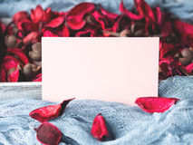 Blank paper note for Valentine`s day and flower petals Stock Photography