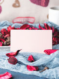 Blank paper note for Valentine`s day and flower petals Stock Image