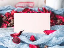 Blank paper note for Valentine`s day and flower petals Royalty Free Stock Image