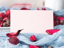 Blank paper note for Valentine`s day and flower petals Stock Images