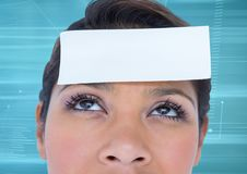 Blank paper note on woman forehead Royalty Free Stock Photography