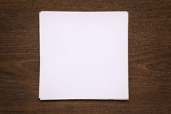 Blank paper note on wood background Stock Photos