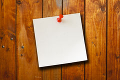 Blank paper note on wood board background Stock Image