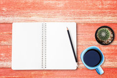 Blank paper notebook and black pencil on the table Royalty Free Stock Photography