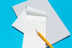 Blank paper notebook on blue background royalty free stock image