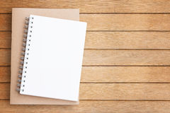 Blank paper notebook on brown wooden table Royalty Free Stock Image
