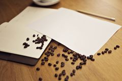 Blank paper with a notebook with a cup of coffee Stock Photos