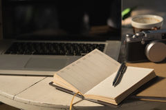 Blank paper notebook and pen on with vintage tone,journal concept. Royalty Free Stock Image