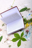 Blank paper notebook on white vintage background with scrapbooking elements Royalty Free Stock Images