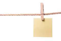 Blank paper notes hanging on rope with clothes pins, copy space Royalty Free Stock Image