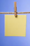 Blank paper notes hanging on rope with clothes pins, copy space Royalty Free Stock Images