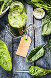 Blank paper notes sign on green healthy Spinach smoothie in bottle Stock Photo