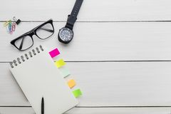 Blank paper notes with wristwatch on the table. Father`s day concept. High angle view of blank paper notes with wristwatch and glasses on the table stock image