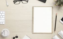 Blank paper on office desk with copy space beside royalty free stock photography