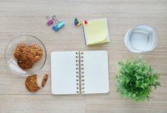 Blank paper and office tools on the wood table - Top view Royalty Free Stock Images