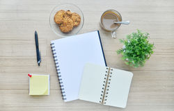Blank paper and office tools on the wood table - Top view Royalty Free Stock Photos