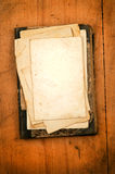 Blank paper with old book as background Stock Photos