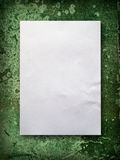 Blank paper on old green wall. Blank White A4 paper on green old wall background Royalty Free Stock Images