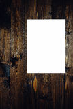 Blank paper on old wooden wall background Royalty Free Stock Images