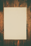 Blank paper on old wooden wall background Royalty Free Stock Image