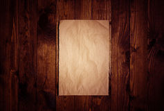 Blank paper on old wooden wall background Stock Photos