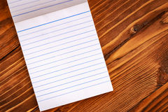 Blank paper on old wooden wall background Stock Photo