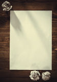 Blank paper on old wooden wall background Royalty Free Stock Photos