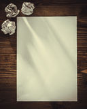 Blank paper on old wooden wall background Royalty Free Stock Photography