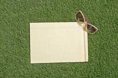 Blank Paper On Grass Royalty Free Stock Photo