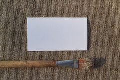 Blank paper and paintbrush on sacking Stock Photo