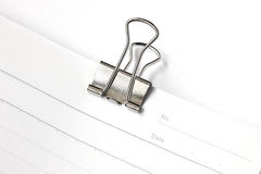 Blank paper with paper clip isolated on white Stock Image