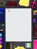 Blank paper with paperclip and school supplies frame on chalkboard Royalty Free Stock Photos
