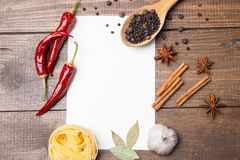 Blank paper with pasta, pepper and spices Royalty Free Stock Images