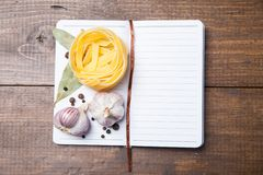 Blank paper with pasta, pepper and spices Royalty Free Stock Image
