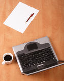 Blank paper, pen cup of coffee and laptop on the desk. Office royalty free stock image