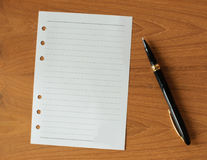 Blank paper with pen Royalty Free Stock Image