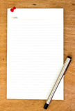Blank paper and pen on wooden Royalty Free Stock Photos