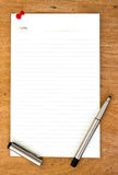 Blank paper and pen on wooden Royalty Free Stock Photography