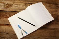 Blank paper, pencil and  compasses, on the wooden table. Stock Photo