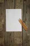Blank paper and pencils on dark wood background Stock Images