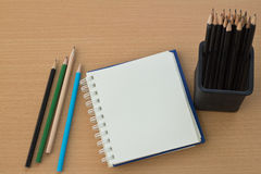 Blank paper and pencils. On old wooden table Stock Images
