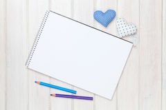 Blank paper, pencils and valentines day heart shaped toys on the Stock Image