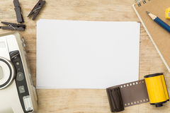 Blank paper with photo film in cartridge and film camera Stock Images