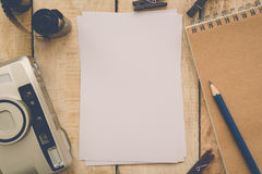 Blank paper with photo film in cartridge and film camera Stock Image